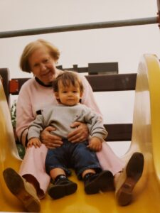 Woman and child on yellow slide
