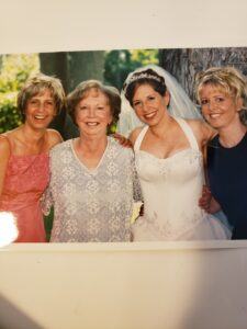Bride and three other women smiling