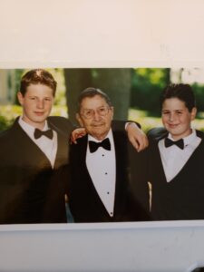 Grandfather with two grandsons in tuxedos