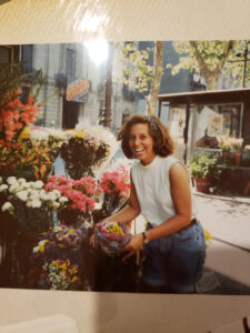 Vintage-photo-of-woman-smiling-with-flower-display